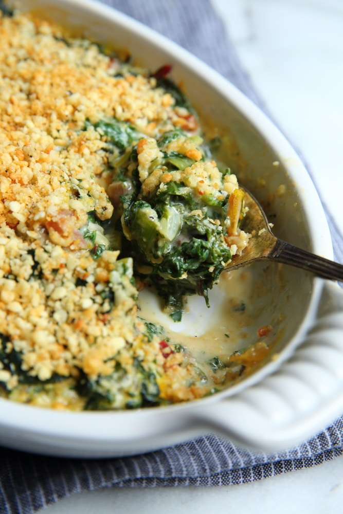 Swiss chard gratin in baking dish with spoon