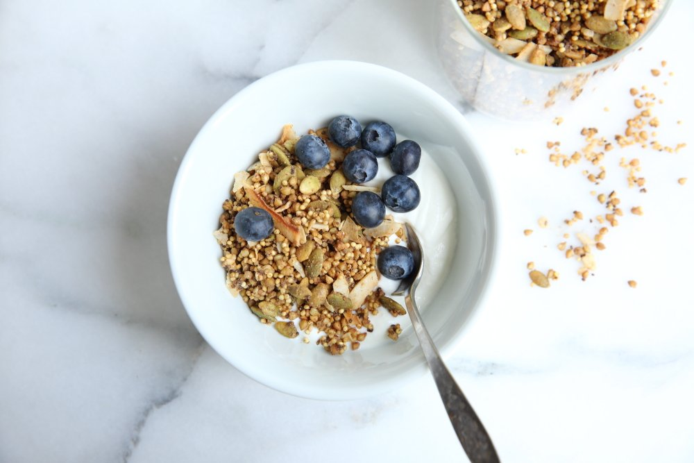 Millet granola in bowl with yogurt and blueberries