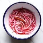 Pickled red onions in bowl for slow cooker carnitas
