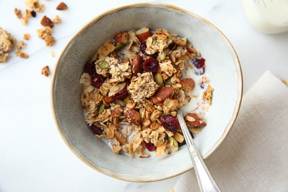 gluten free granola recipe in bowl with milk and spoon