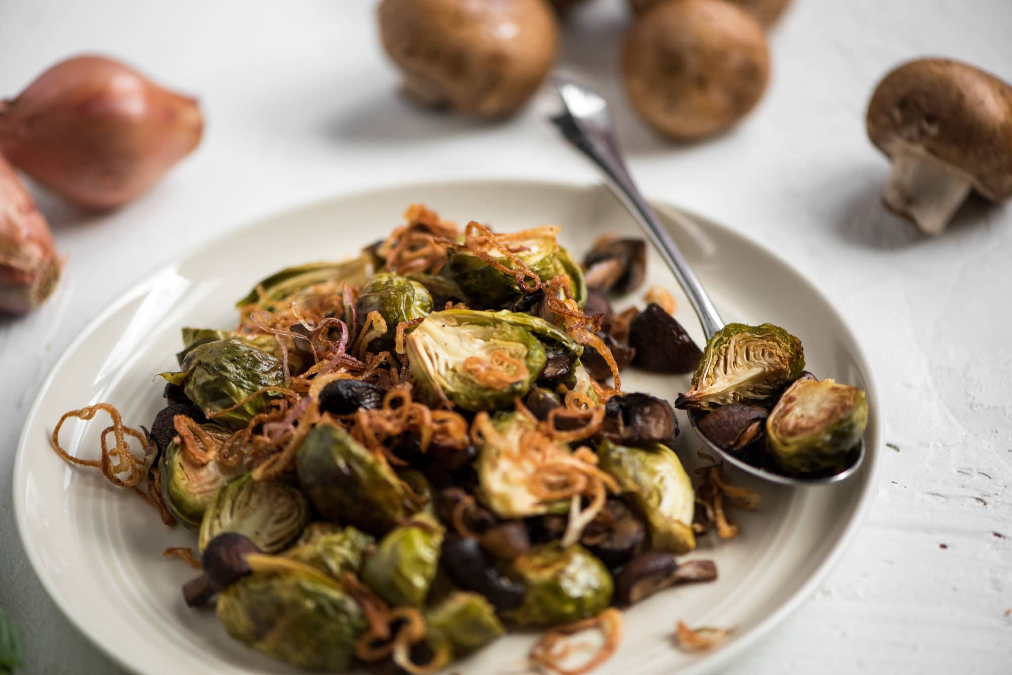 Caramelized Brussels sprouts with mushrooms and fried shallots