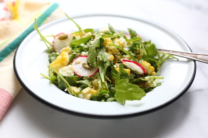 Close-up side view of corn salad.