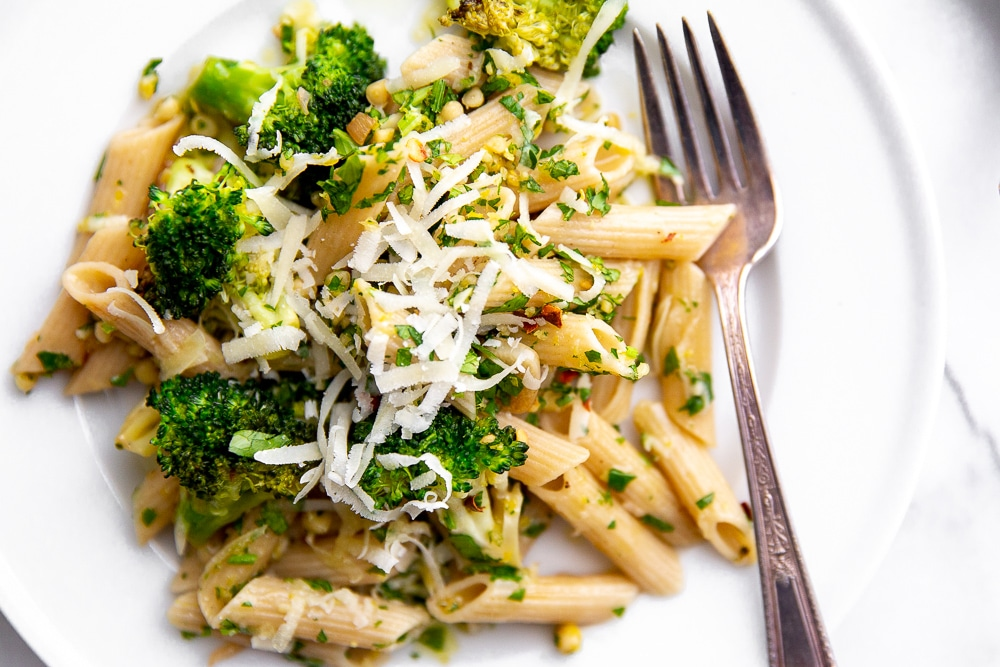 Broccoli pasta on plate with grated Pecorino cheese