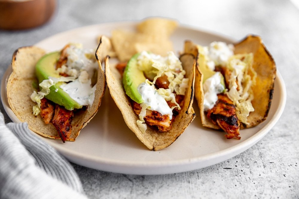 Easy chipotle chicken tacos lined up on a plate
