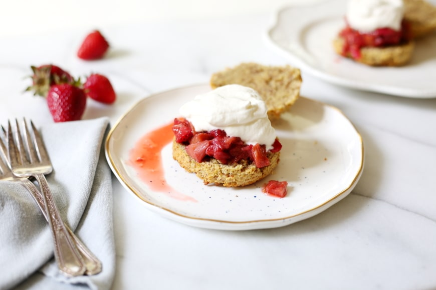 Paleo almond shortcakes on plate with whipped cream and berries