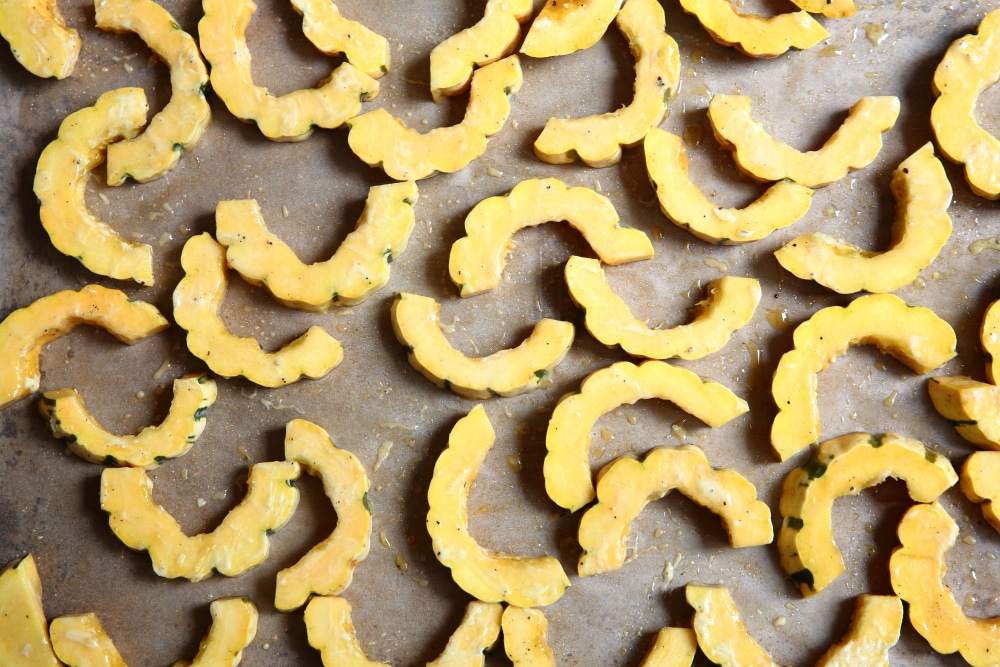 Delicata squash rings on a baking sheet.