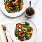 Roasted squash salad on a plate.
