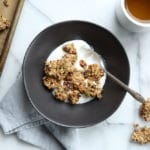 Easy granola clusters recipe, granola clusters in bowl with yogurt