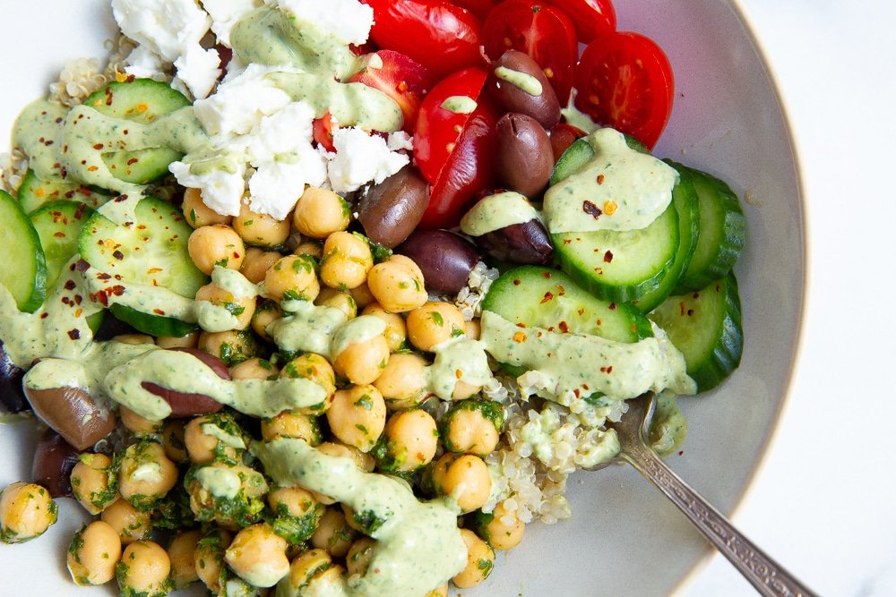 Mediterranean quinoa bowl with green tahini sauce