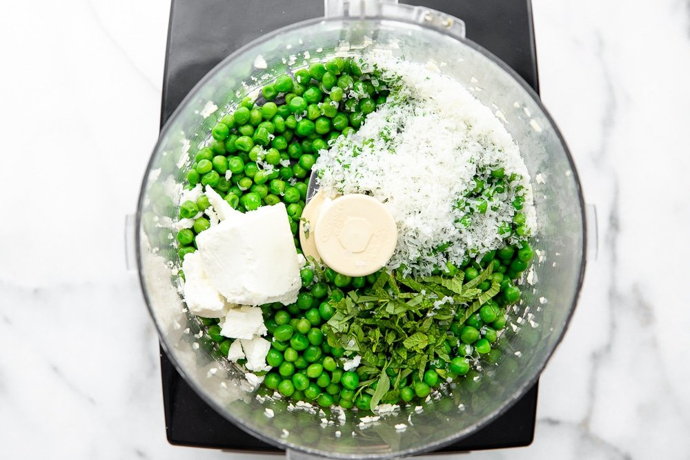 Process shot showing ingredients for dip in food processor