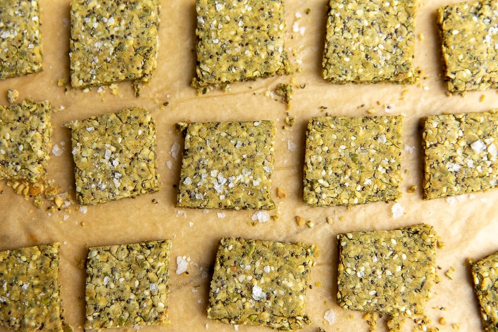 Close-up of seed crackers on parchment paper