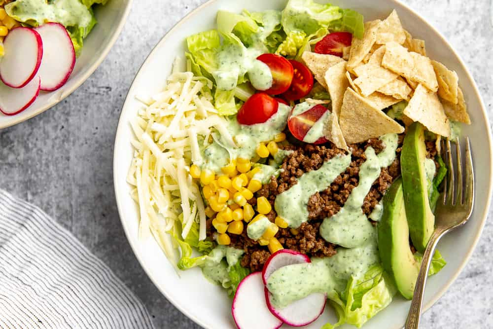 Close-up of healthy taco salad in bowl with fork