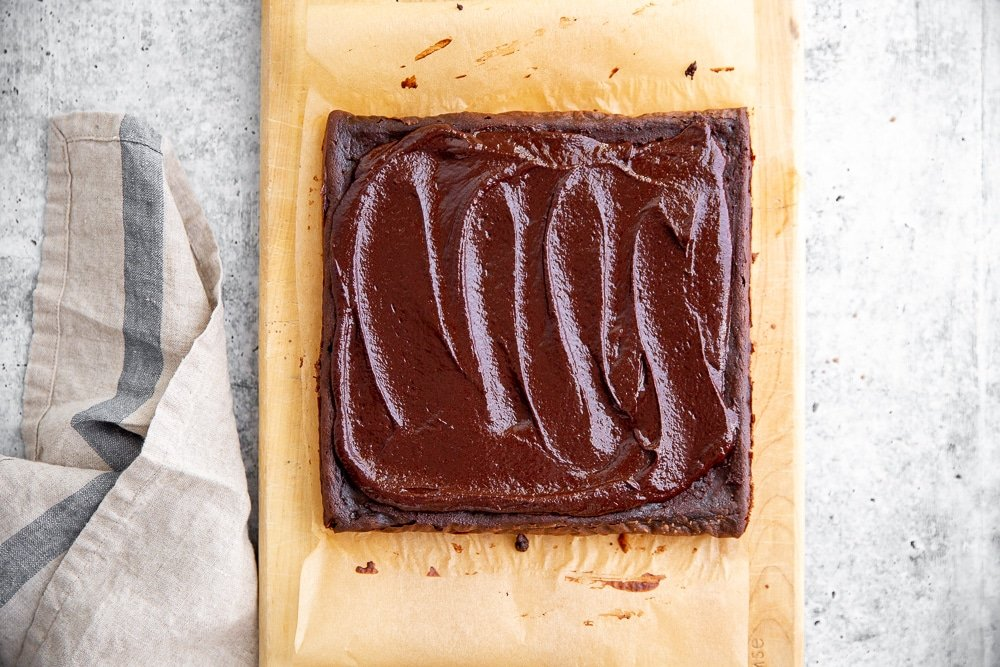 Overhead shot of black bean brownies topped with easy cacao frosting.