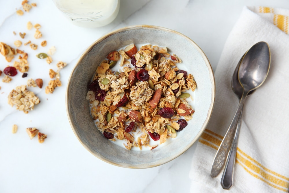 Gluten free granola in a bowl with spoons alongside.