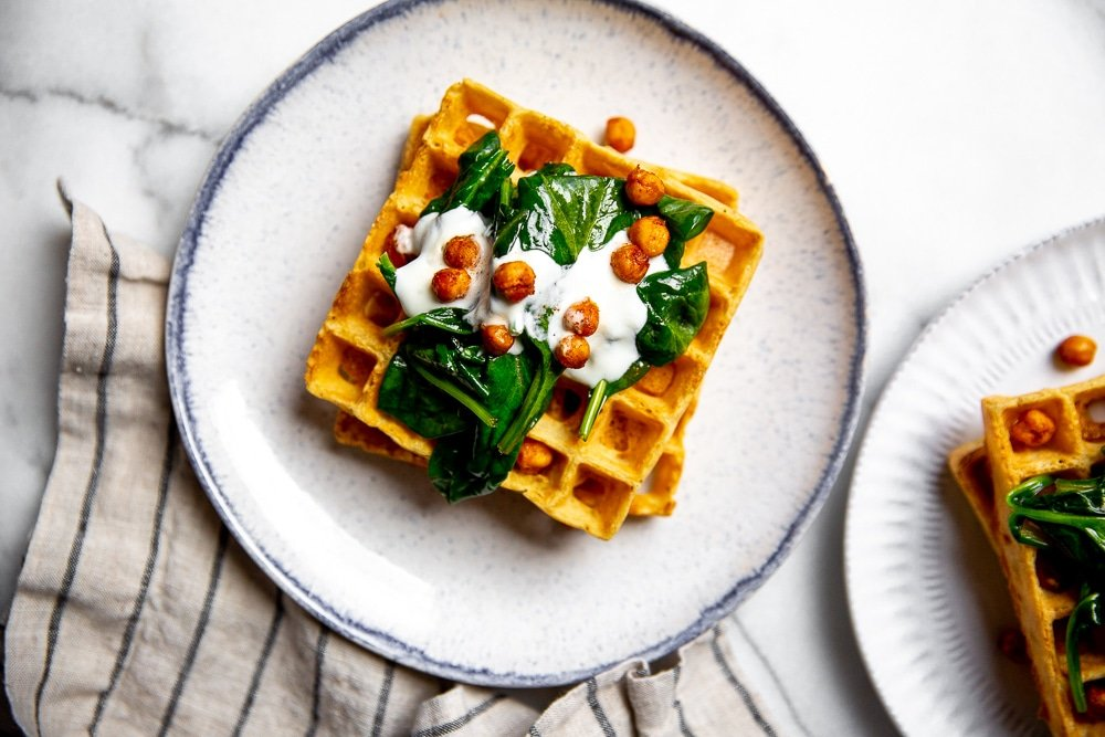Chickpea waffles on a plate.