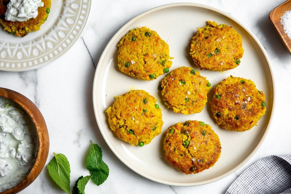 Curried millet cakes, a pantry recipe, on a plate.
