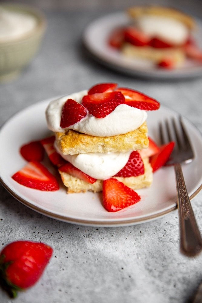 Close up of an easy strawberry shortcake on a plate with a fork.