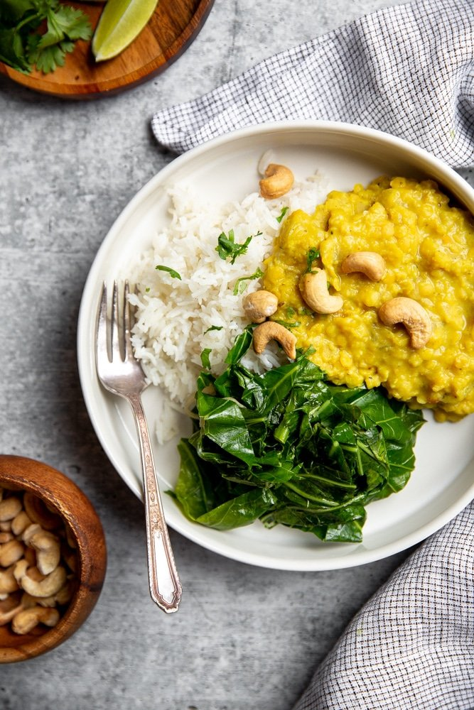 Red lentil dal over rice with sautéed kale and cashews.