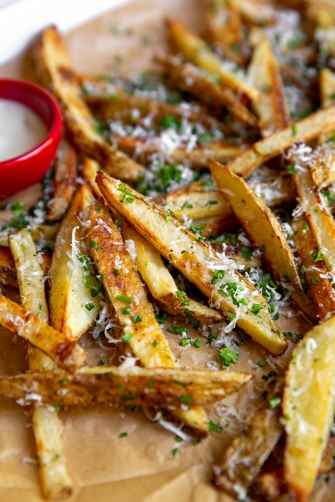 Close up of healthy baked oven French Fries on a platter.