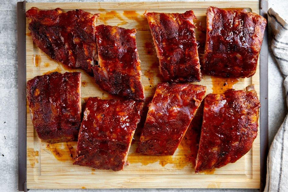 Smoked ribs on a cutting board.