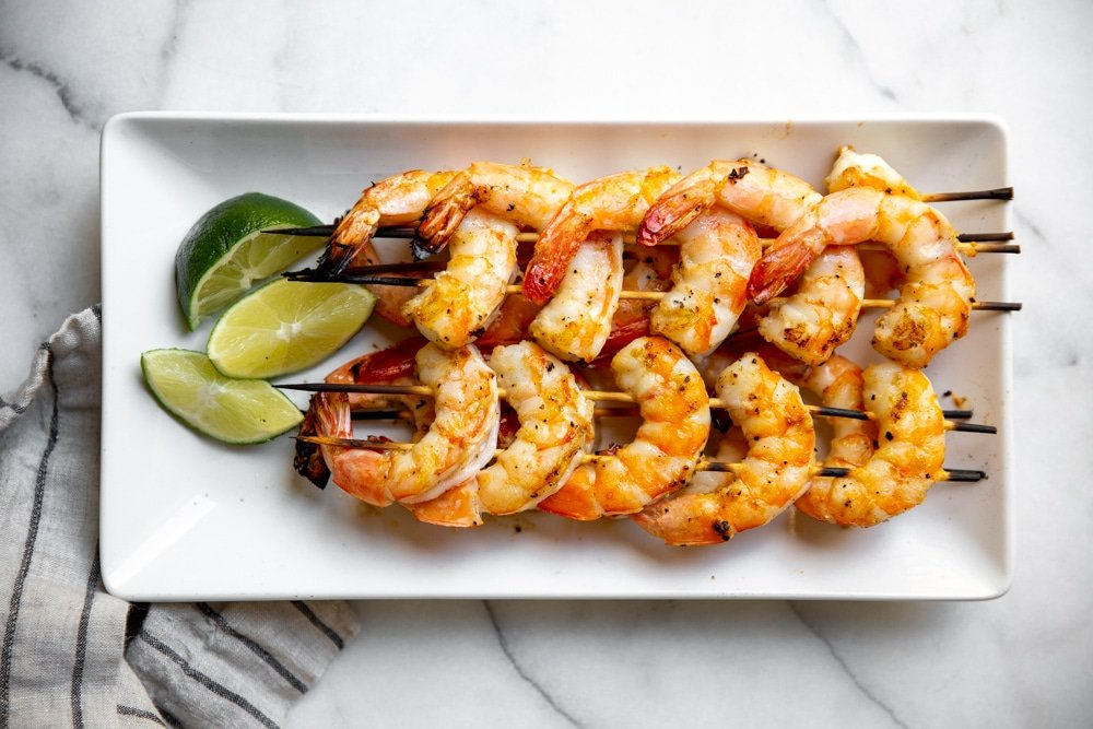 Grilled shrimp skewers on a platter.