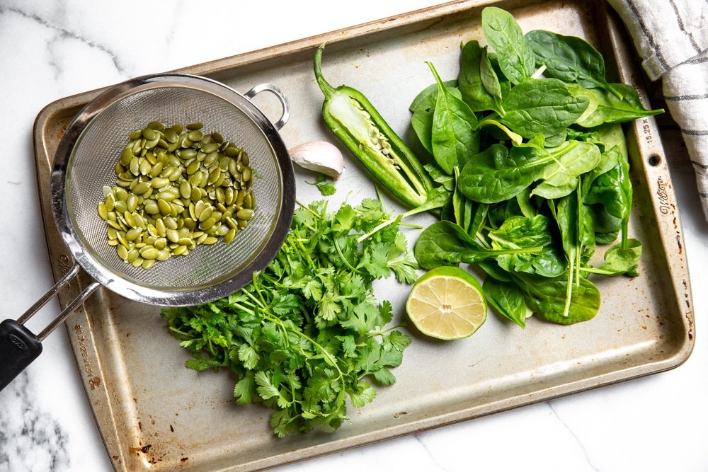 The ingredients for the cilantro lime pesto arranged on a baking sheet.