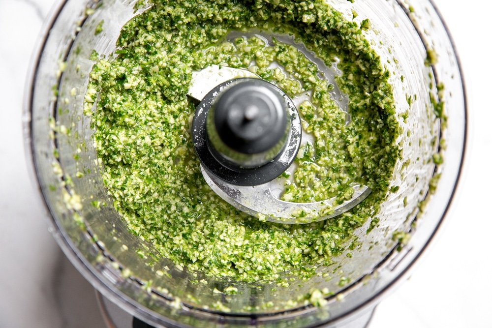 Close up of the cilantro lime pesto in a food processor.