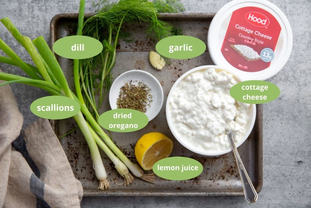 All of the ingredients for the healthy cottage cheese dip arranged on a pan.