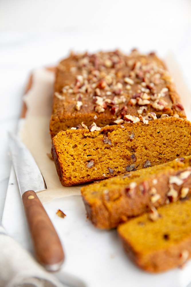 Pumpkin bread sliced on a serving board.