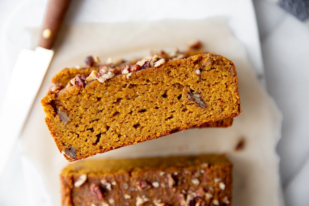 Close up of a slice of paleo pumpkin bread.