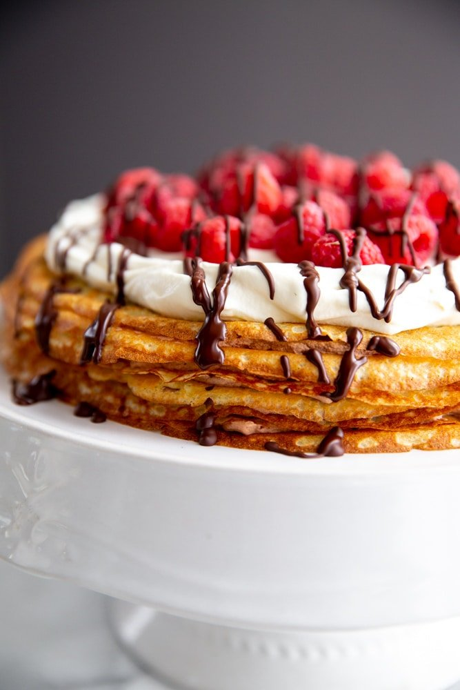 Close up of an easy crepe cake on a cake stand.
