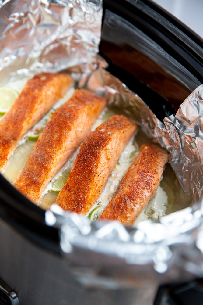 Poached salmon fillets in a slow cooker.