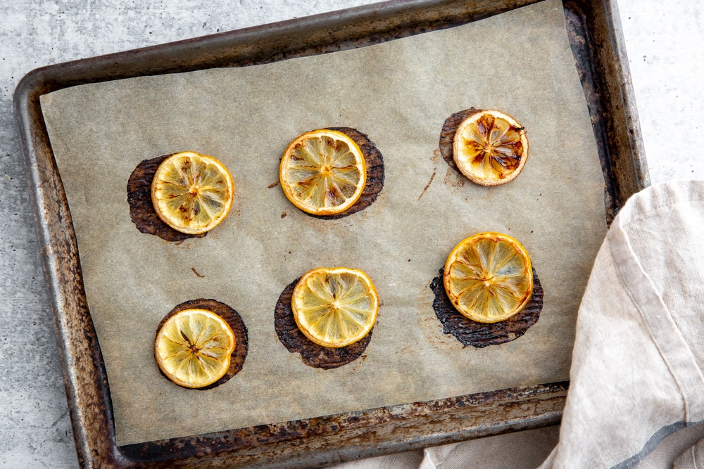 Baked lemon slices on a baking sheet.